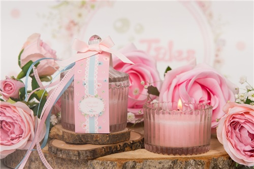 CANDLE IN PINK GLASS JAR